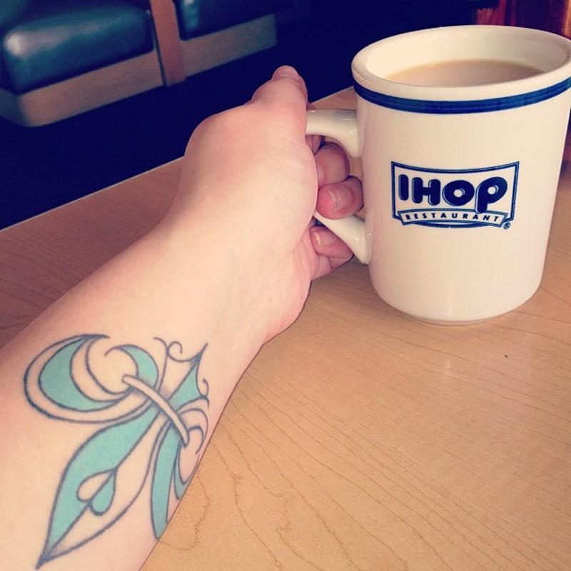 Fleur de lis tattoo on forearm 3