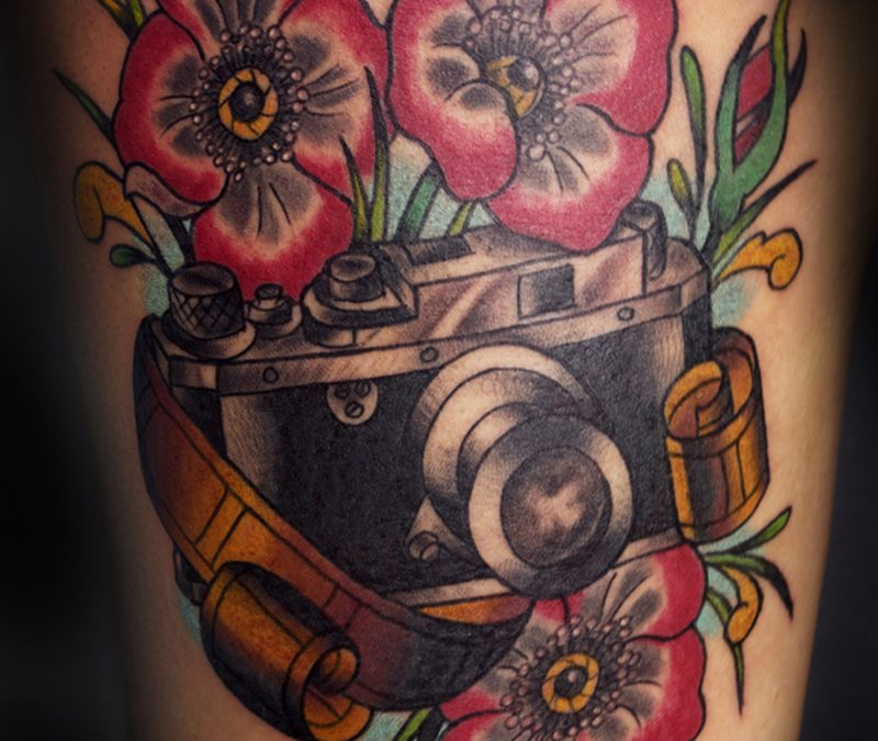 Floral camera tattoo design with film
