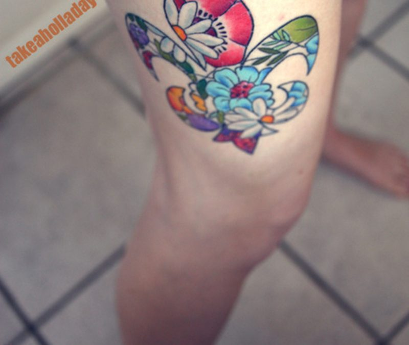 Floral fleur de lis tattoo on thigh for girls
