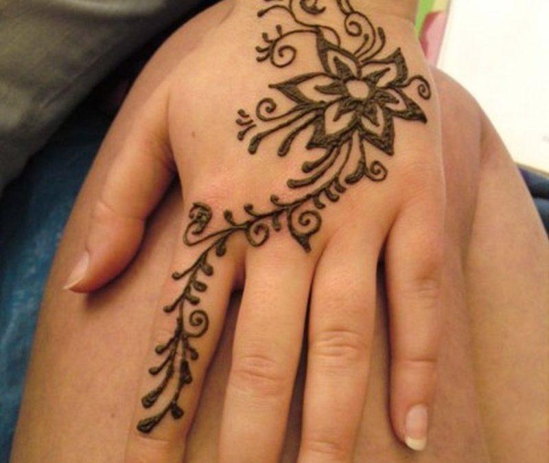 Floral henna tattoo design on hand