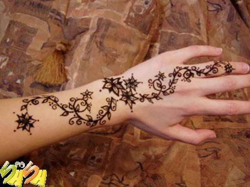 Floral henna tattoo on hand