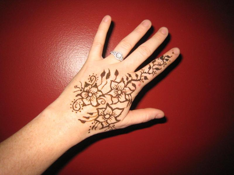 Floral henna tattoo on left hands