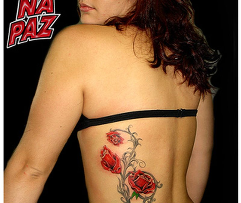 Floral tattoo on rib for women