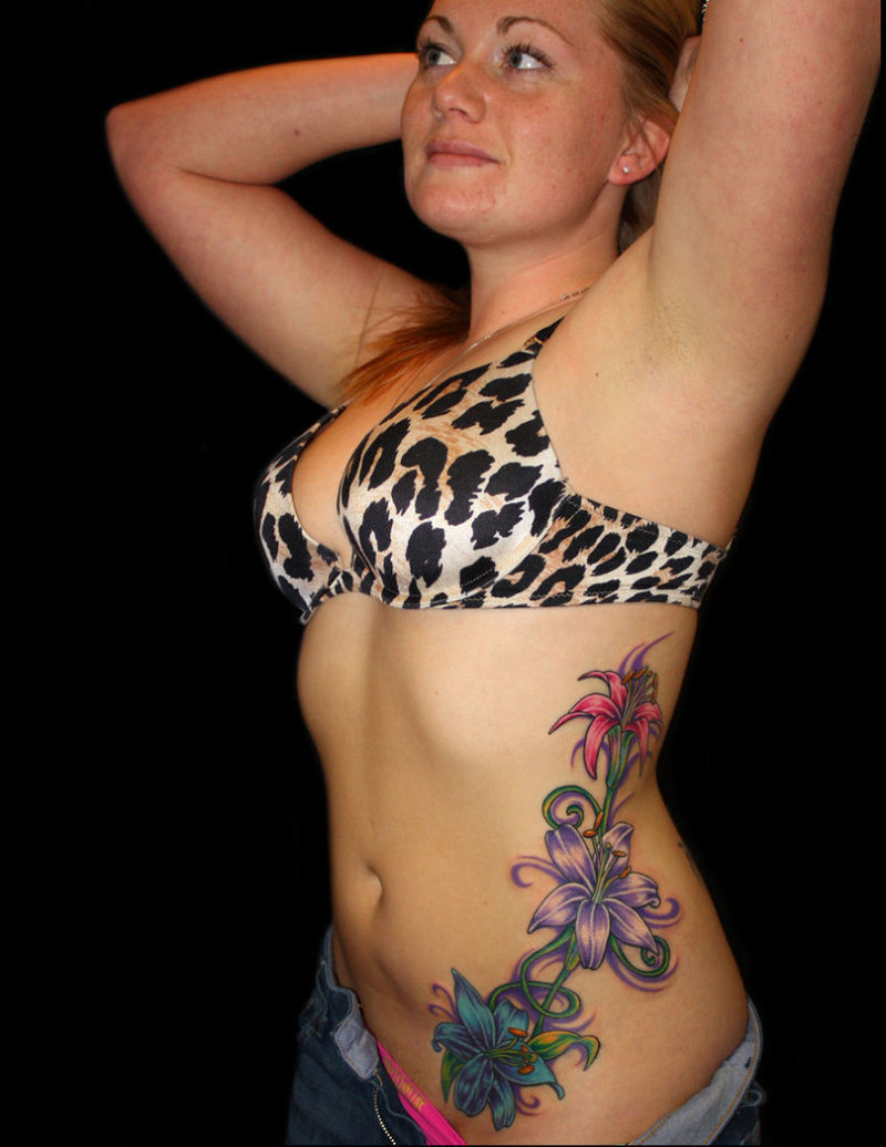 Floral tattoo on rib side for women