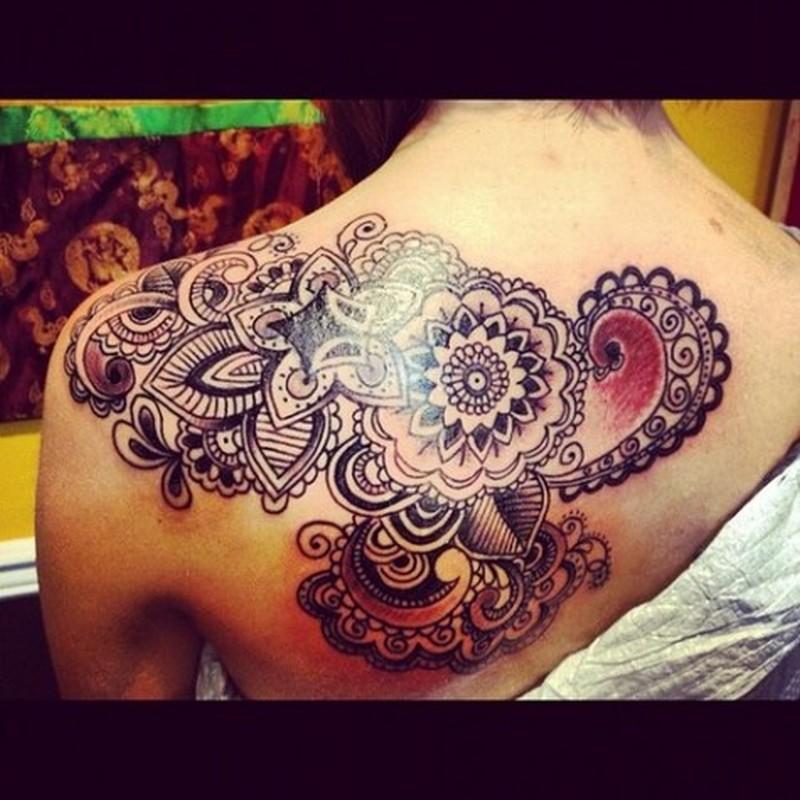 Floral upper back tattoo design