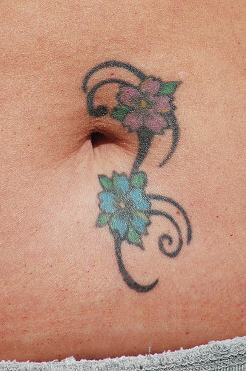 Flower belly button tattoo design