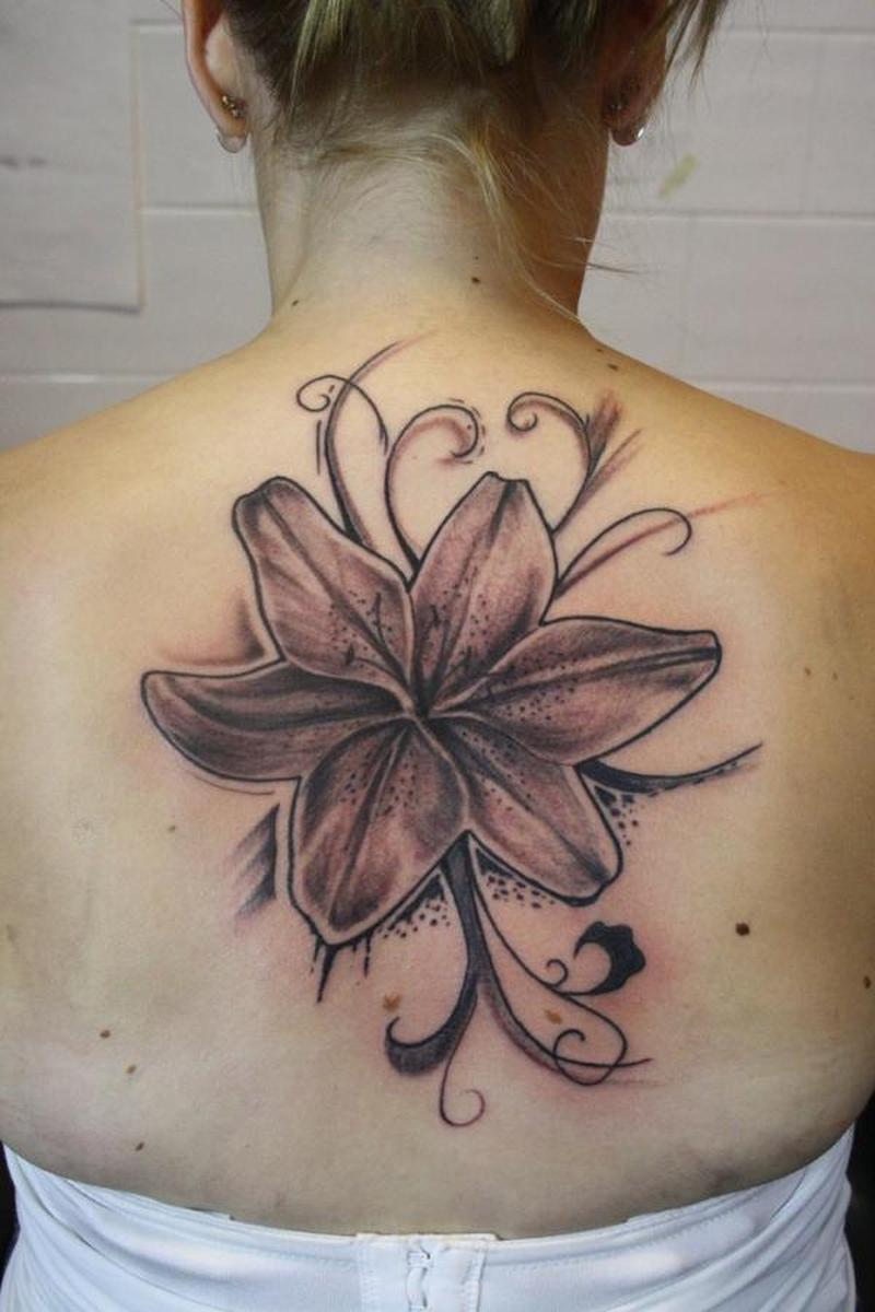 Flower on upper back for girls tattoo