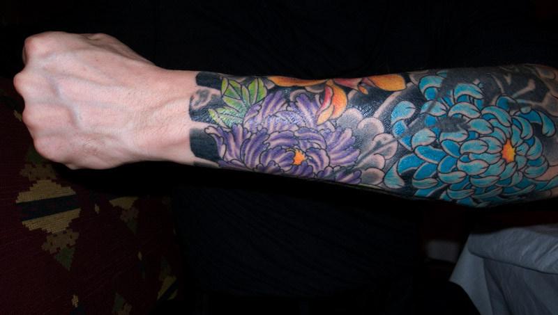 Flower tattoo design for men on forearm