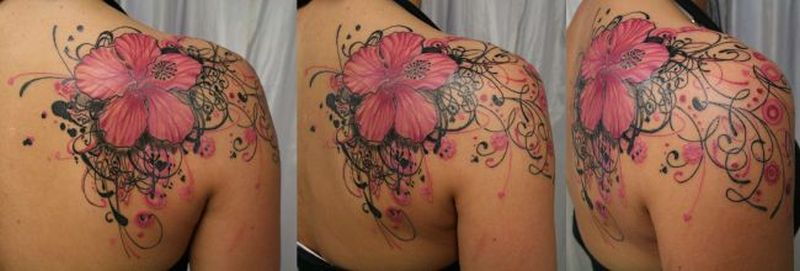 Flower tattoo on right back shoulder