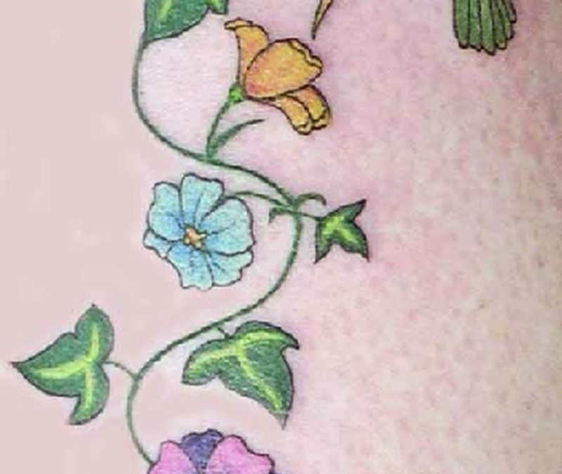 Flower vine n green hummingbird tattoo design
