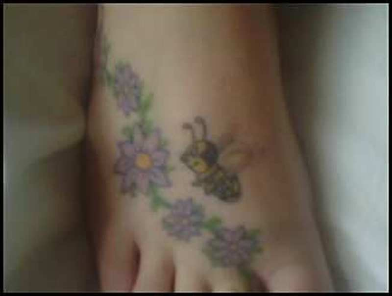 Flowers a bumblebee tattoo