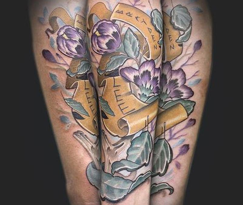 Flowers with banner tattoo design on forearms