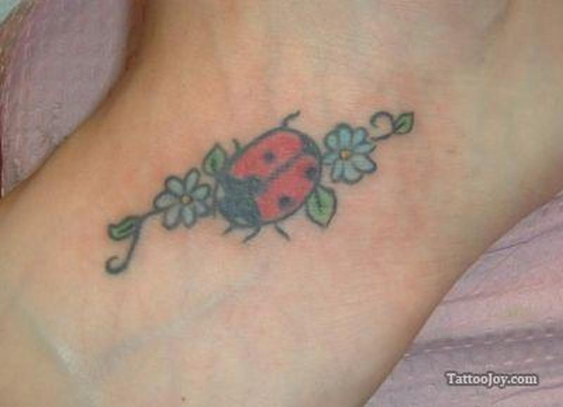 Flowers with lady bug tattoo design
