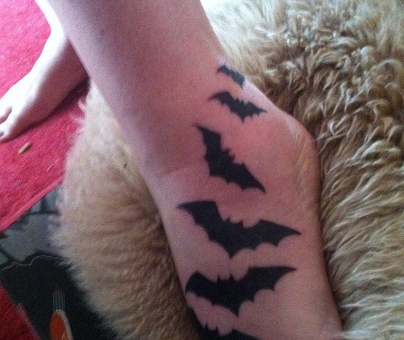 Flying bats tattoo on foot
