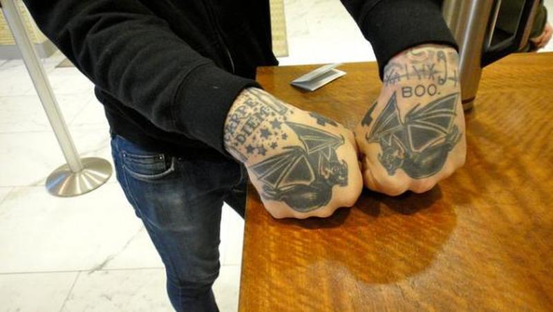 Flying bats tattoo on hands