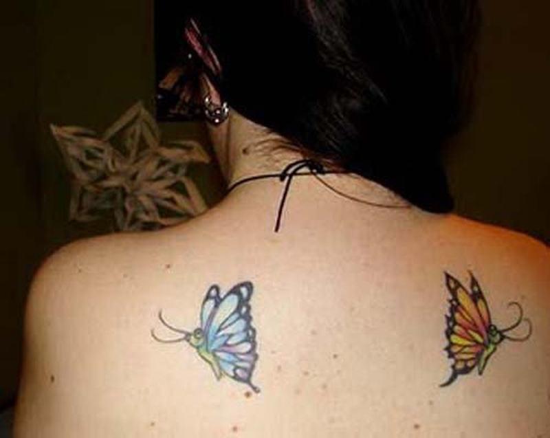 Flying butterflies tattoo