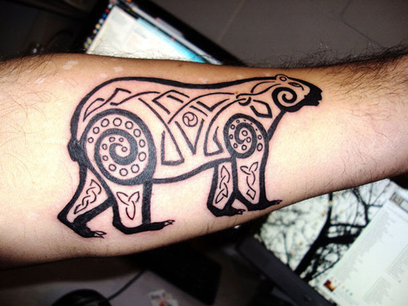 Forearm bear tattoo