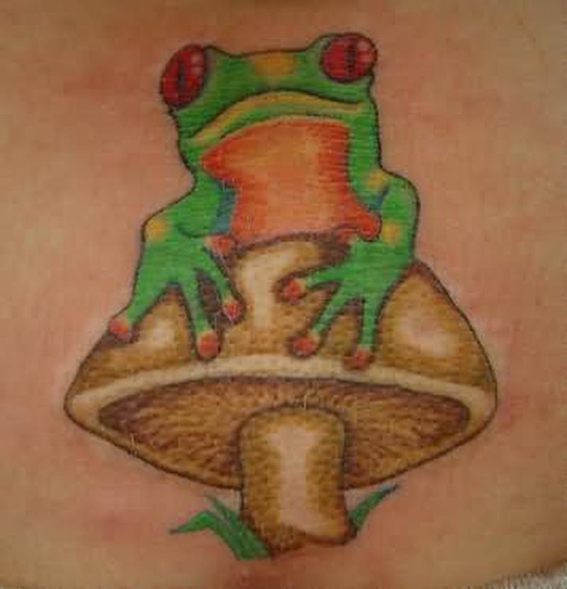 Frog sitting on mushroom tattoo design