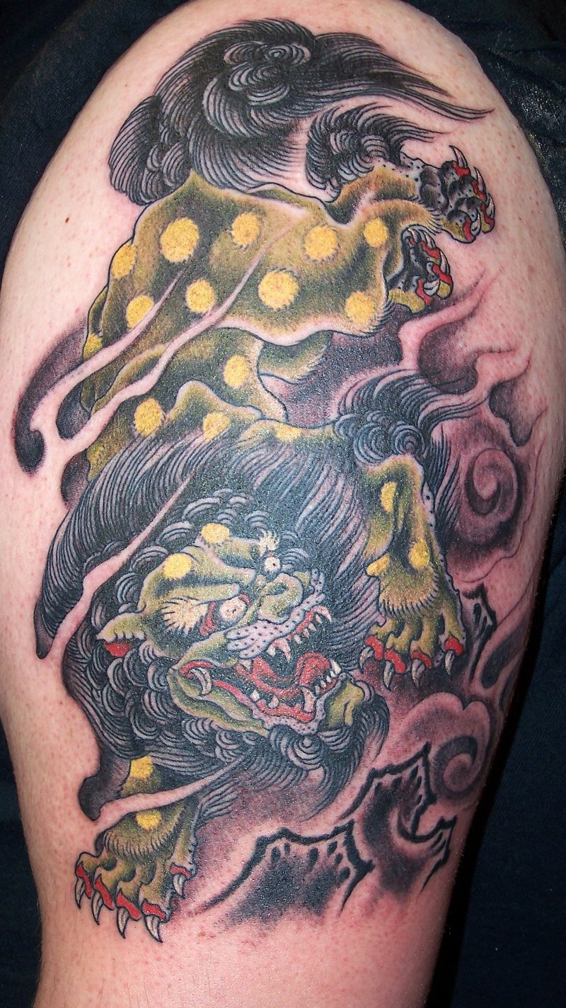Fu dog tattoo on half sleeve 2