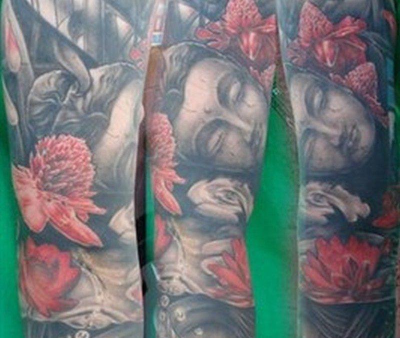 Full sleeve religious asian tattoo