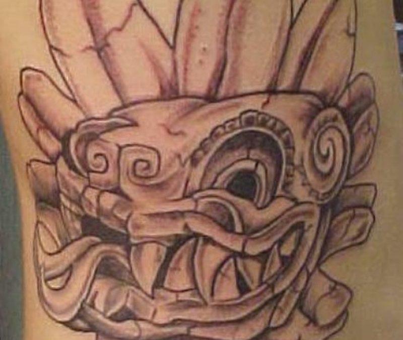 Funky aztec on rib tattoo