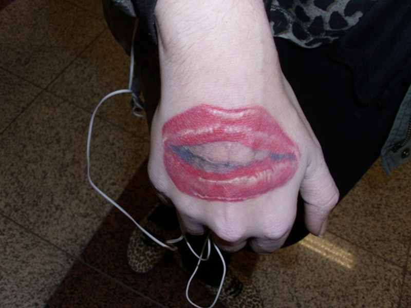 Funky lips tattoo on right hand