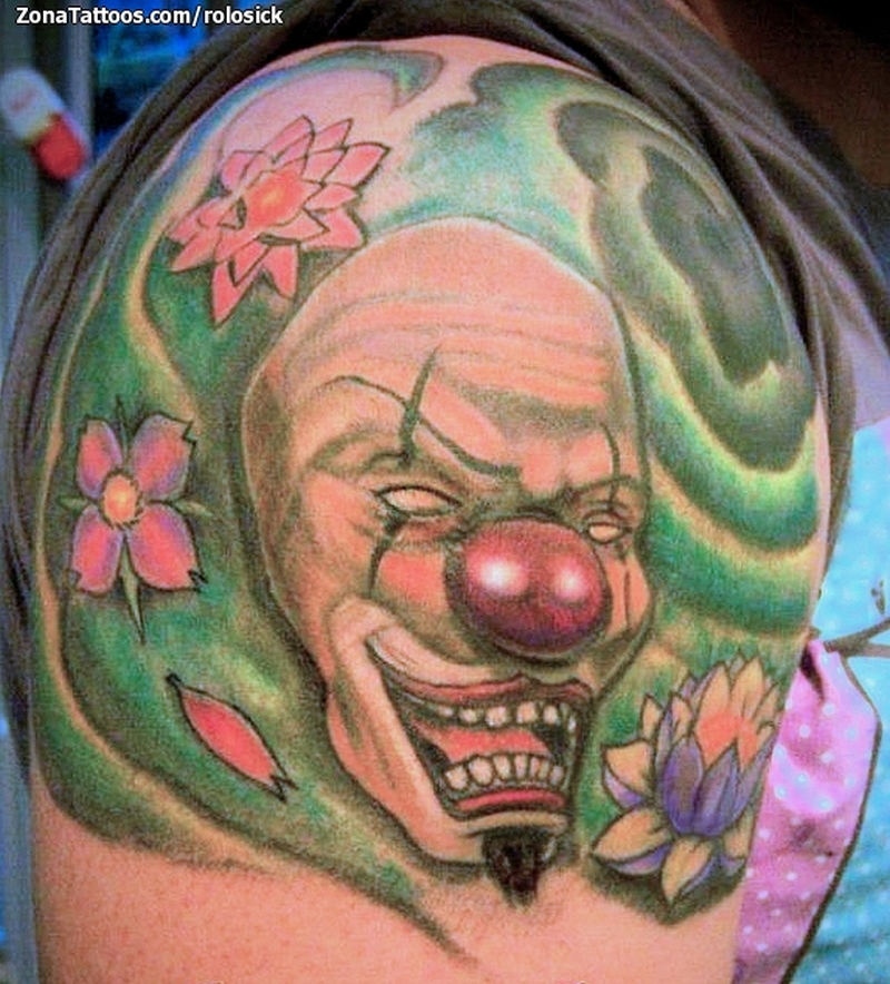 Funny clown tattoo on shoulder