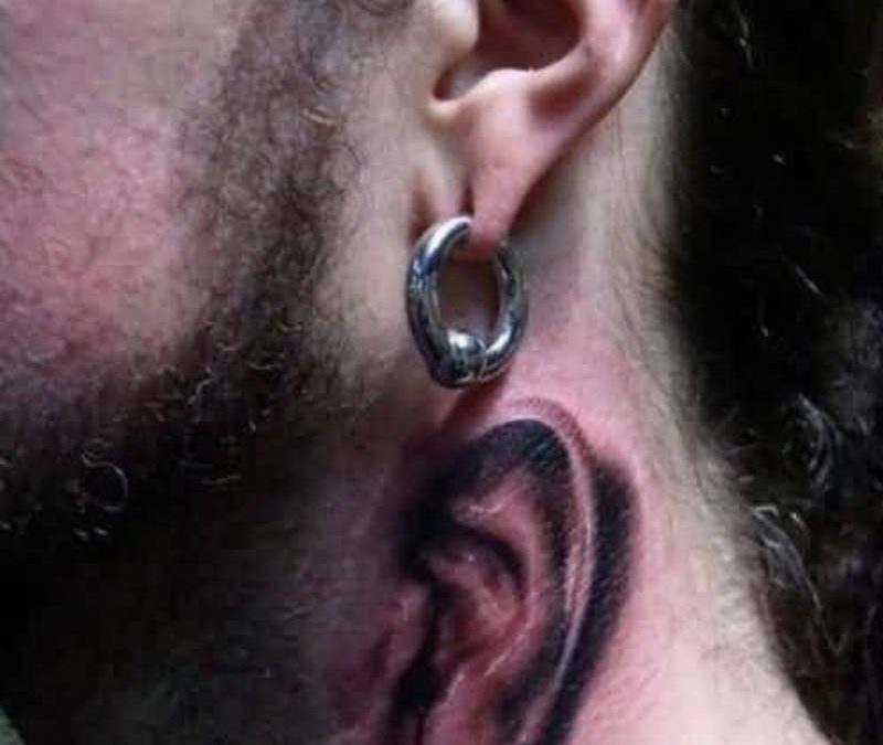 Funny ear tattoo on neck