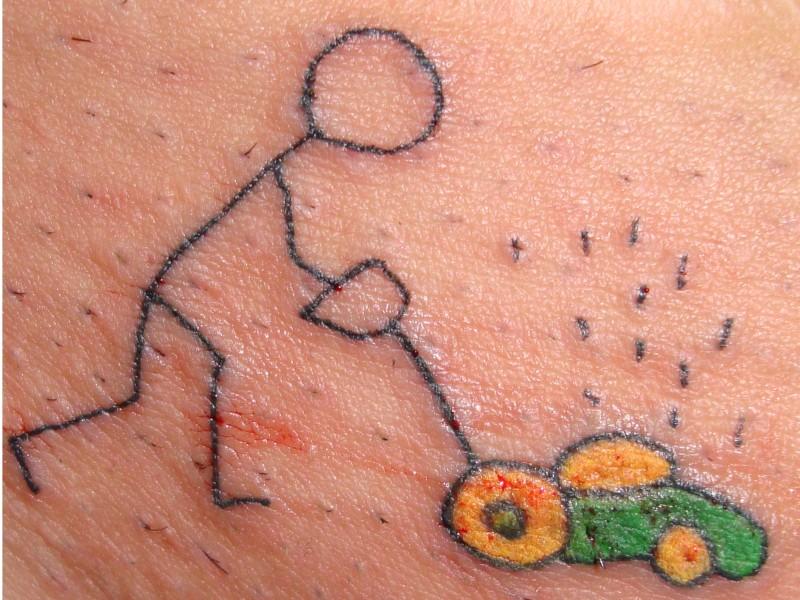 Funny lawn mower tattoo design