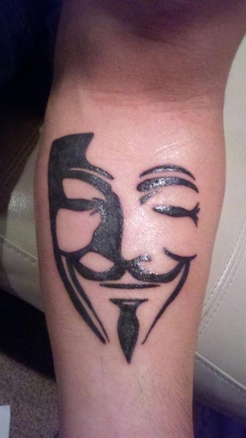 Funny mask tattoo on leg