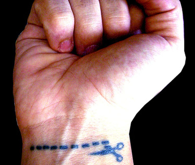 Funny scissor tattoo on wrist