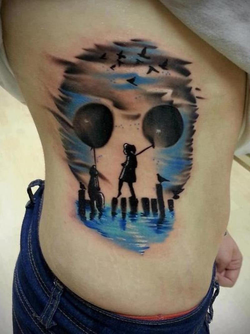 Funny skull tattoo on side