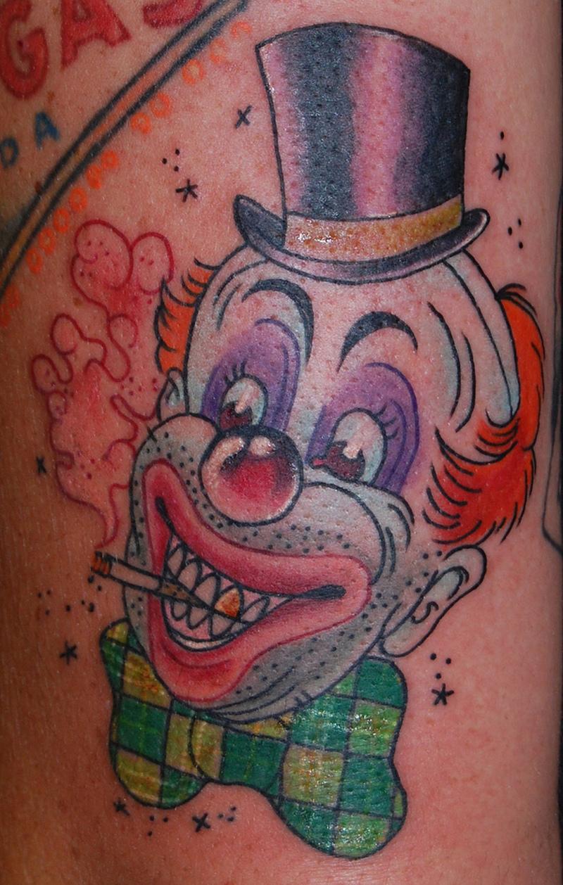 Funny smoking clown tattoo