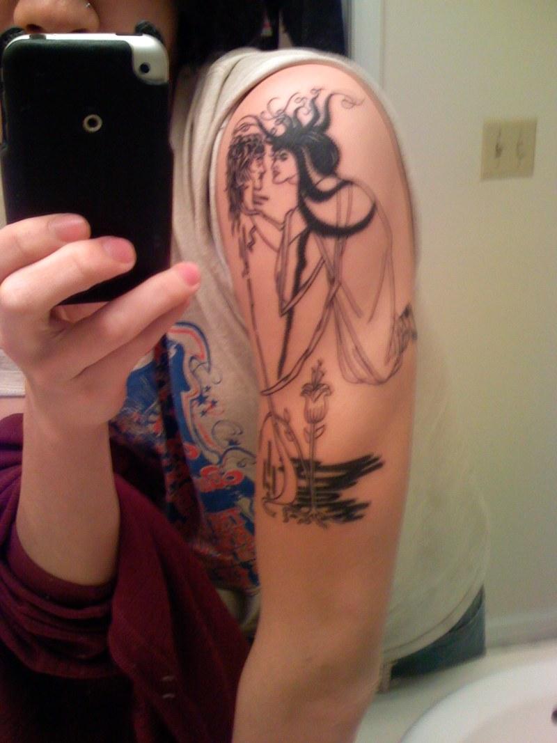 Funny tattoo on left arm