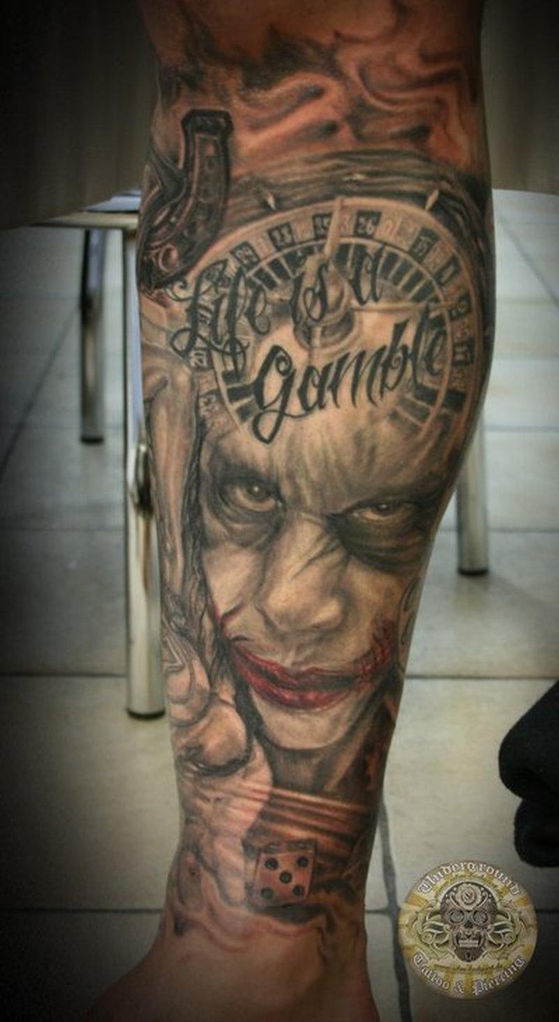 Gambling joker tattoo on leg
