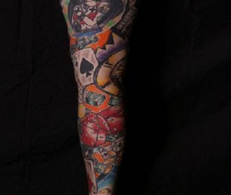 Gambling tattoo on arm