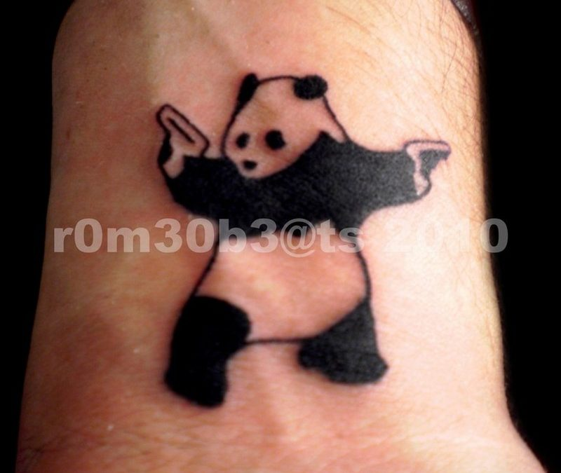 Gangsta panda tattoo on wrist