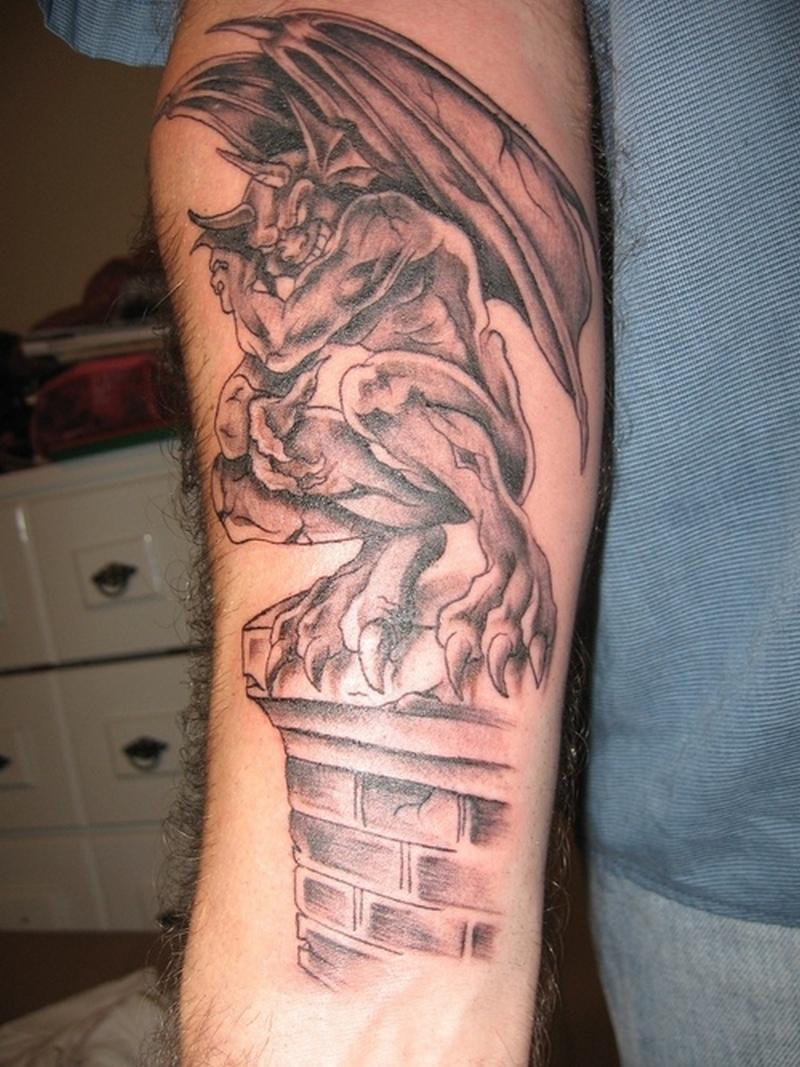 Gargoyle tattoo on forearm