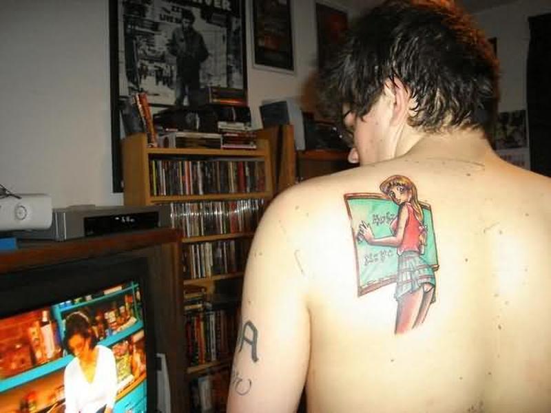 Geek girl tattoo on back of shoulder