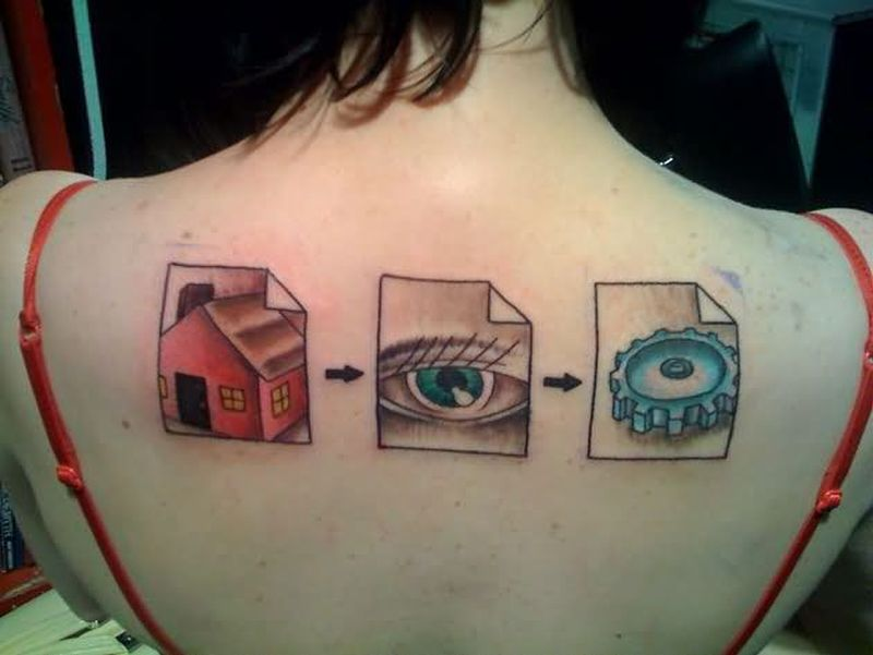 Geek tattoo on upper back for girls