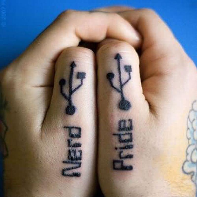 Geek usb tattoo on thumbs