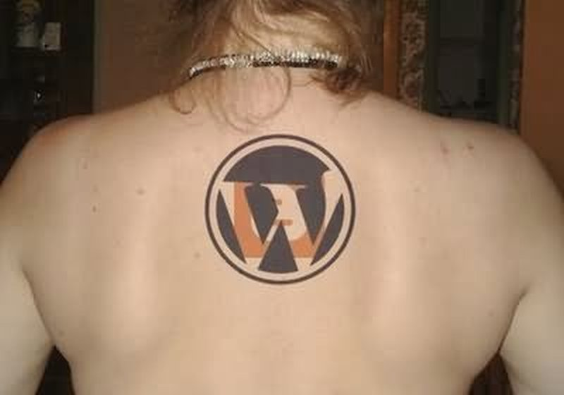 Geek wordpress logo tattoo on upper back