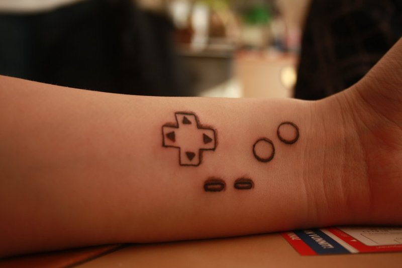 Geeky tattoo on wrist