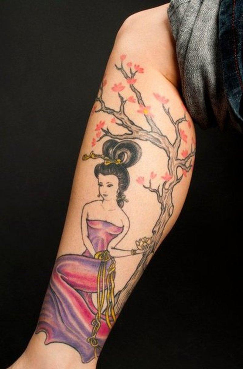Geisha n cherry blossoms tattoo on leg