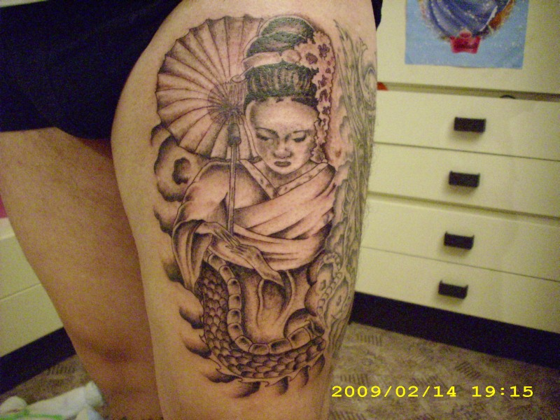 Geisha tattoo on left thigh
