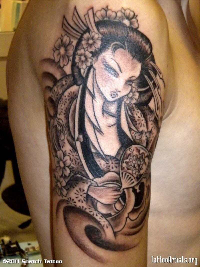 Geisha tattoo picture on right upper arm
