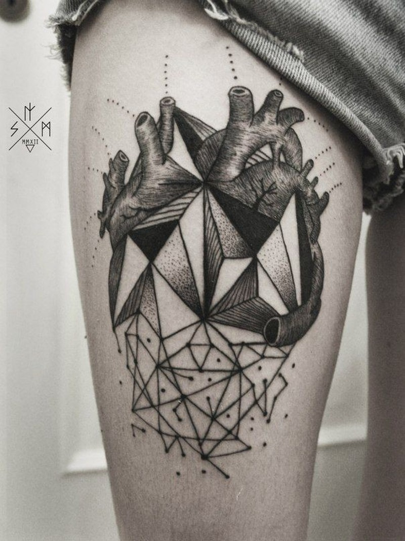Geometric abstraction heart tattoo on thigh