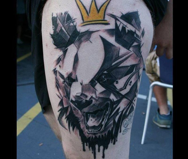 Geometric bear in crown tattoo on thigh