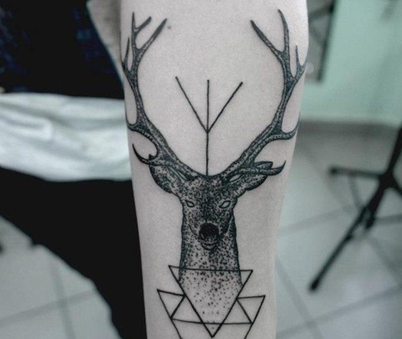 Geometric deer tattoo on forearm