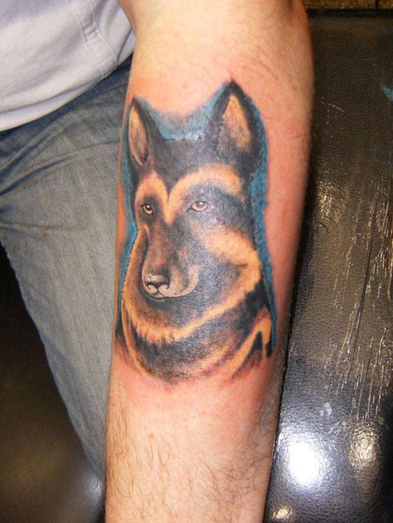 German shepherd dog tattoo on forearm